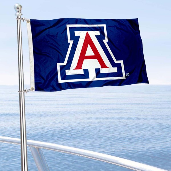 Arizona Wildcats Boat and Mini Flag is 12x18 inches, polyester, offers quadruple stitched flyends for durability, has two metal grommets, and is double sided. Our mini flags for University of Arizona are licensed by the university and NCAA and can be used as a boat flag, motorcycle flag, golf cart flag, or ATV flag.