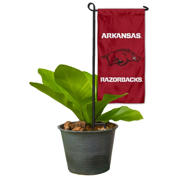 "Arkansas Razorbacks Flower Pot Topper Flag kit includes our 4""x8"" mini garden banner and 6"" x 14"" mini garden banner stand. The mini flag is made of 1-ply polyester, has screen printed logos and the garden stand is made of steel and powder coated black. This kit is NCAA Officially Licensed by the selected college or university."