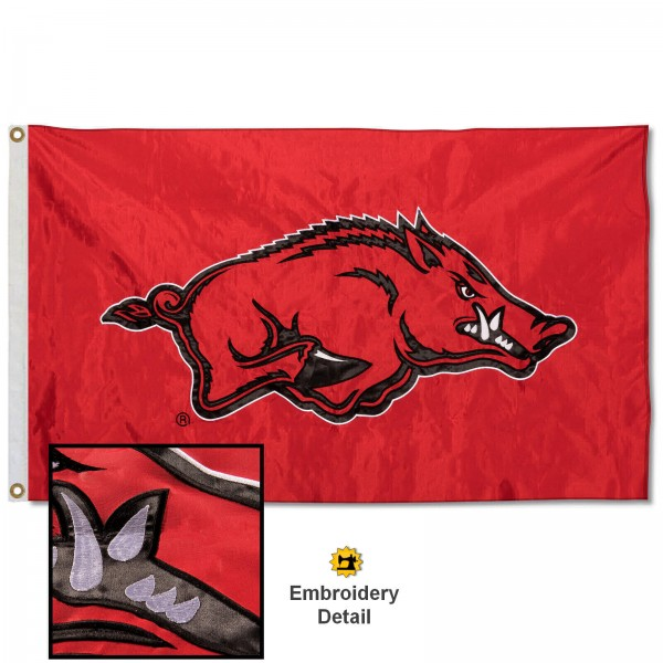 Arkansas Razorbacks Nylon Embroidered Flag measures 3'x5', is made of 100% nylon, has quadruple flyends, two metal grommets, and has double sided appliqued and embroidered University logos. These Arkansas Razorbacks 3x5 Flags are officially licensed by the selected university and the NCAA.