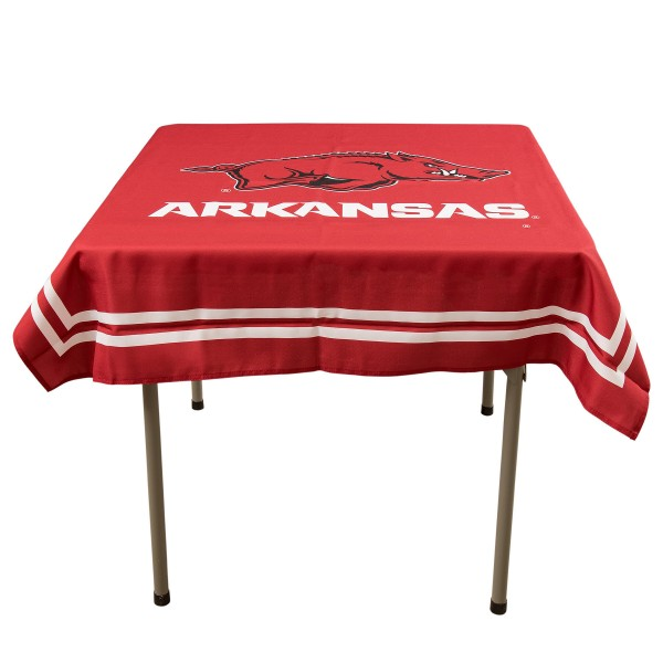 Arkansas Razorbacks Table Cloth measures 48 x 48 inches, is made of 100% Polyester, seamless one-piece construction, and is perfect for any tailgating table, card table, or wedding table overlay. Each includes Officially Licensed Logos and Insignias.