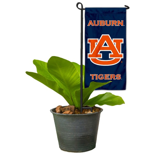 "Auburn Tigers Flower Pot Topper Flag kit includes our 4""x8"" mini garden banner and 6"" x 14"" mini garden banner stand. The mini flag is made of 1-ply polyester, has screen printed logos and the garden stand is made of steel and powder coated black. This kit is NCAA Officially Licensed by the selected college or university."