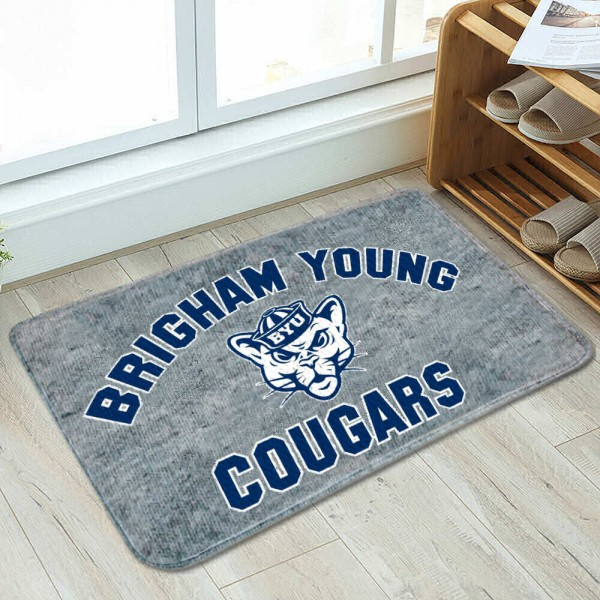 Brigham Young Cougars Cushioned Floor Bathmat measures 17x26 inches rectangular, is made of polyester felt blends, has a durable non-slip rubber backing, and is UV, mildew, and stain resistant. Each college bath mat includes Officially Licensed Logos and Insignias.