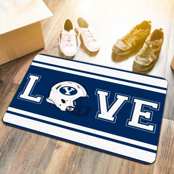 Brigham Young Cougars LOVE Garage Man Cave Utility Doormat measures 17x25 inches rectangular, is made of polyester felt blends, has a durable non-slip rubber backing, and is UV, mildew, and stain resistant. Each college doormat includes Officially Licensed Logos and Insignias.