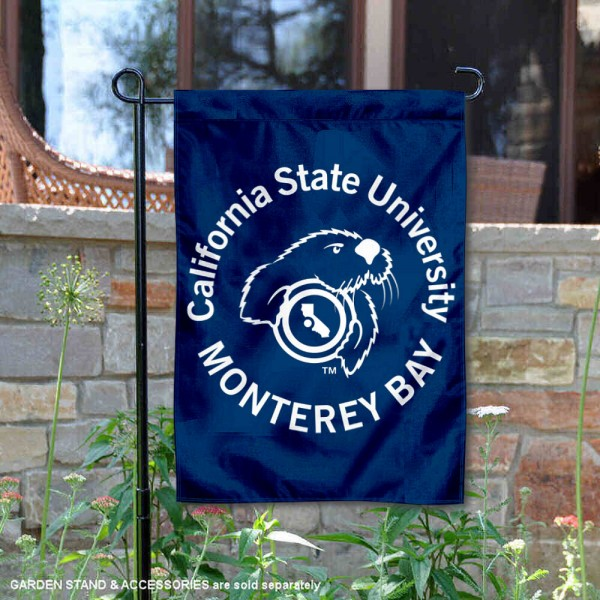 Cal State Monterey Otters Wordmark Logo Garden Flag is 13x18 inches in size, is made of 2-layer polyester, screen printed university athletic logos and lettering, and is readable and viewable correctly on both sides. Available same day shipping, our Cal State Monterey Otters Wordmark Logo Garden Flag is officially licensed and approved by the university and the NCAA.