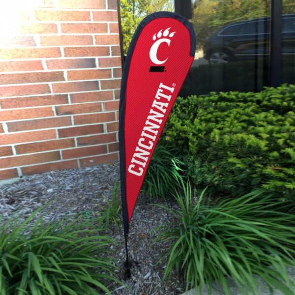 Cincinnati Bearcats Small Feather Flag measures a 4' tall when fully assembled and roughly 1' wide. The kit includes a Feather Flag, 2 Piece Fiberglass Pole, pole connector, and matching Ground Stake. Our Cincinnati Bearcats Small Feather Flag easily assembles and is NCAA Officially Licensed by the selected school or university.