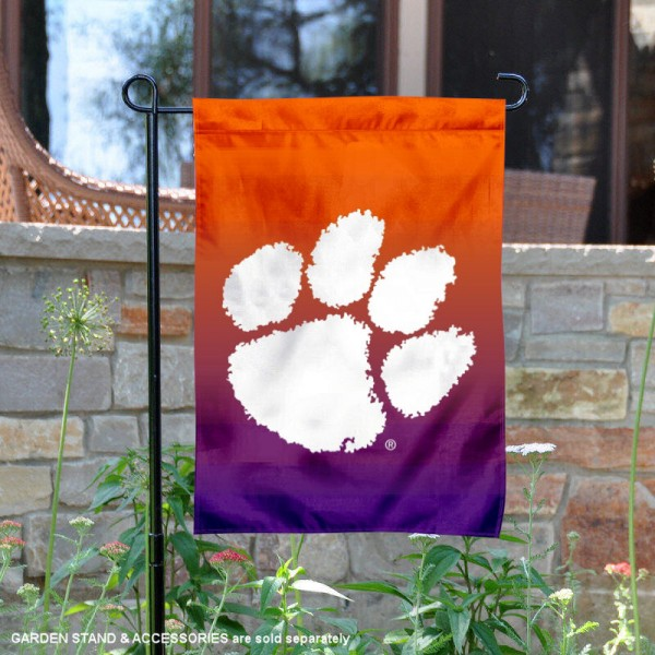 Clemson Gradient Ombre Logo Garden Flag is 13x18 inches in size, is made of thick blockout polyester, screen printed university athletic logos and lettering, and is readable and viewable correctly on both sides. Available same day shipping, our Clemson Gradient Ombre Logo Garden Flag is officially licensed and approved by the university and the NCAA.
