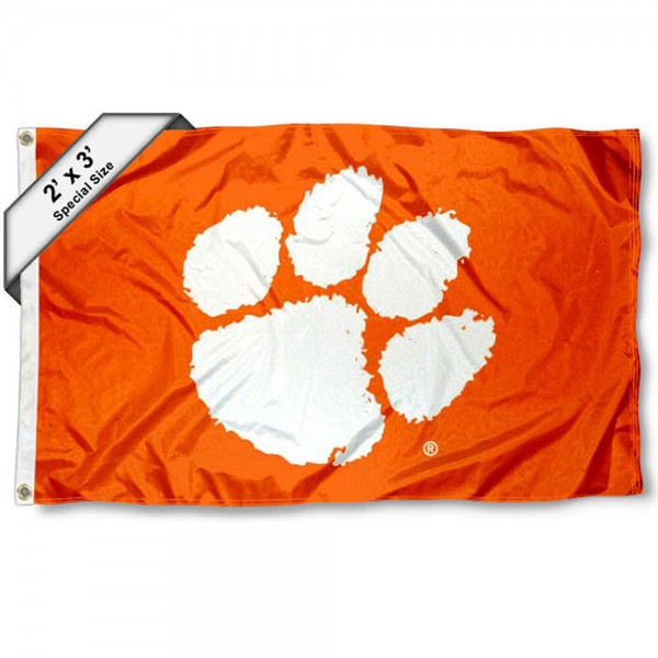 Clemson Small 2'x3' Flag measures 2x3 feet, is made of 100% polyester, offers quadruple stitched flyends, has two brass grommets, and offers printed Clemson logos, letters, and insignias. Our 2x3 foot flag is Officially Licensed by the selected university.