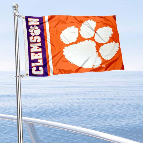 Clemson Tigers Double Sided Boat Flag is 12x18 inches, nylon, offers quadruple stitched flyends for durability, has two metal grommets, and is double sided. Our mini flags for Clemson Tigers are licensed by the university and NCAA and can be used as a boat flag, motorcycle flag, golf cart flag, or ATV flag.