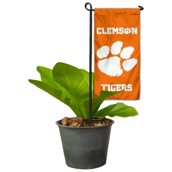 "Clemson Tigers Flower Pot Topper Flag kit includes our 4""x8"" mini garden banner and 6"" x 14"" mini garden banner stand. The mini flag is made of 1-ply polyester, has screen printed logos and the garden stand is made of steel and powder coated black. This kit is NCAA Officially Licensed by the selected college or university."