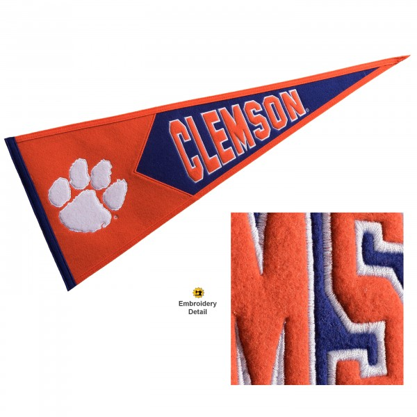 Clemson Tigers Genuine Wool Pennant consists of our full size 13x32 inch Winning Streak Sports wool college pennant. The logos, lettering and insignia is quality embroidered and appliqued, feature a alternate logo color header, and has sewn wool perimeter. This Clemson Tigers College Pennant Pennant is Officially Licensed and University Approved with Overnight Next Day Shipping.