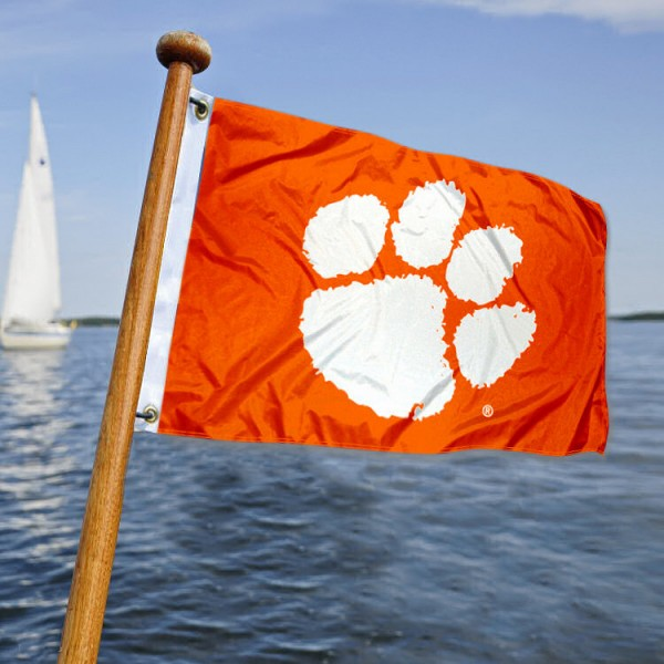 Clemson Tigers Nautical Flag measures 12x18 inches, is made of two-ply polyesters, offers quadruple stitched flyends for durability, has two metal grommets, and is viewable from both sides. Our Clemson Tigers Nautical Flag is officially licensed by the selected university and the NCAA and can be used as a motorcycle flag, golf cart flag, or ATV flag