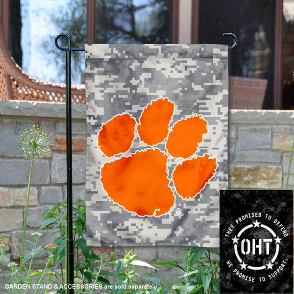 Clemson Tigers Operation Hat Trick Garden Flag is 13x18 inches in size, is made of 2-layer polyester, screen printed university athletic logos and lettering, and is readable and viewable correctly on both sides. Available same day shipping, our Clemson Tigers Operation Hat Trick Garden Flag is officially licensed and approved by the university and the NCAA.