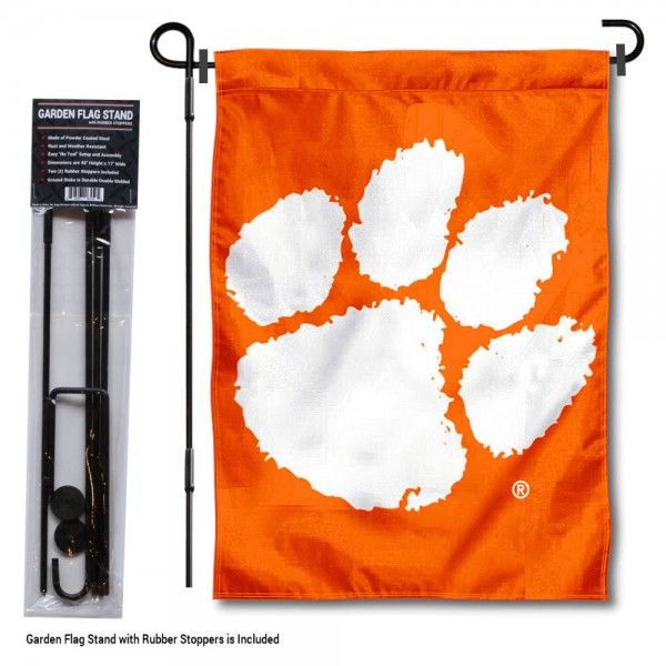 """Clemson Tigers Orange Garden Flag and Stand kit includes our 13""""x18"""" garden banner which is made of 2 ply poly with liner and has screen printed licensed logos. Also, a 40""""x17"""" inch garden flag stand is included so your Clemson Tigers Orange Garden Flag and Stand is ready to be displayed with no tools needed for setup. Fast Overnight Shipping is offered and the flag is Officially Licensed and Approved by the selected team."""