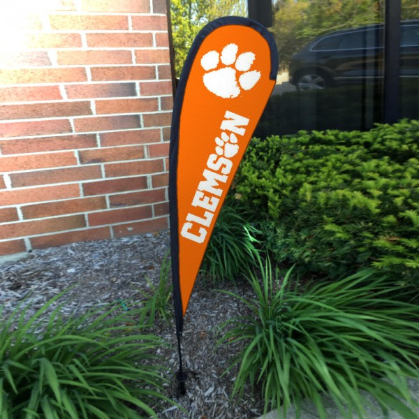 Clemson Tigers Small Feather Flag measures a 4' tall when fully assembled and roughly 1' wide. The kit includes a Feather Flag, 2 Piece Fiberglass Pole, pole connector, and matching Ground Stake. Our Clemson Tigers Small Feather Flag easily assembles and is NCAA Officially Licensed by the selected school or university.