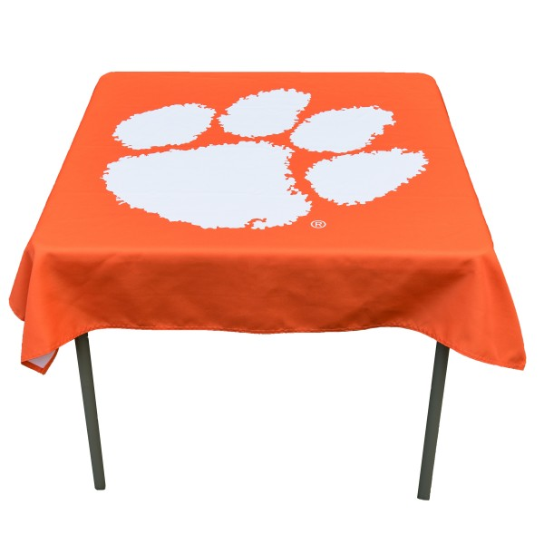 Clemson Tigers Table Cloth measures 48 x 48 inches, is made of 100% Polyester, seamless one-piece construction, and is perfect for any tailgating table, card table, or wedding table overlay. Each includes Officially Licensed Logos and Insignias.