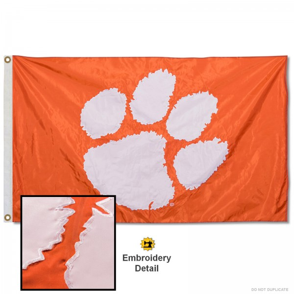 Clemson University Orange Nylon Embroidered Flag measures 3'x5', is made of 100% nylon, has quadruple flyends, two metal grommets, and has double sided appliqued and embroidered University logos. These Clemson University 3x5 Flags are officially licensed by the selected university and the NCAA.