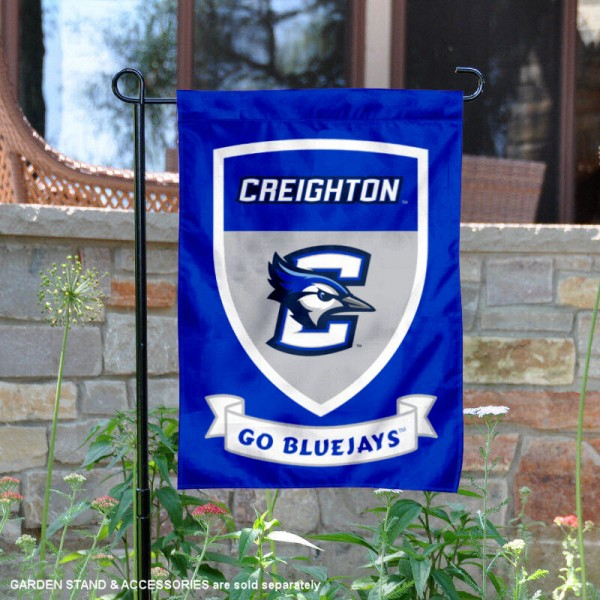 Creighton Jays Go Bluejays Shield Garden Flag is 13x18 inches in size, is made of thick blockout polyester, screen printed university athletic logos and lettering, and is readable and viewable correctly on both sides. Available same day shipping, our Creighton Jays Go Bluejays Shield Garden Flag is officially licensed and approved by the university and the NCAA.