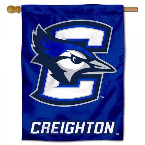 """Creighton Jays House Flag is constructed of polyester material, is a vertical house flag, measures 30""""x40"""", offers screen printed athletic insignias, and has a top pole sleeve to hang vertically. Our Creighton Jays House Flag is Officially Licensed by Creighton Jays and NCAA."""