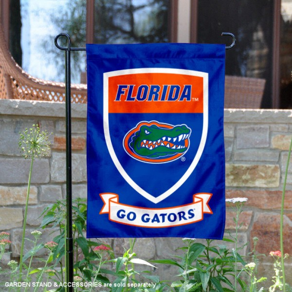 Florida UF Gators Go Gators Shield Garden Flag is 13x18 inches in size, is made of thick blockout polyester, screen printed university athletic logos and lettering, and is readable and viewable correctly on both sides. Available same day shipping, our Florida UF Gators Go Gators Shield Garden Flag is officially licensed and approved by the university and the NCAA.