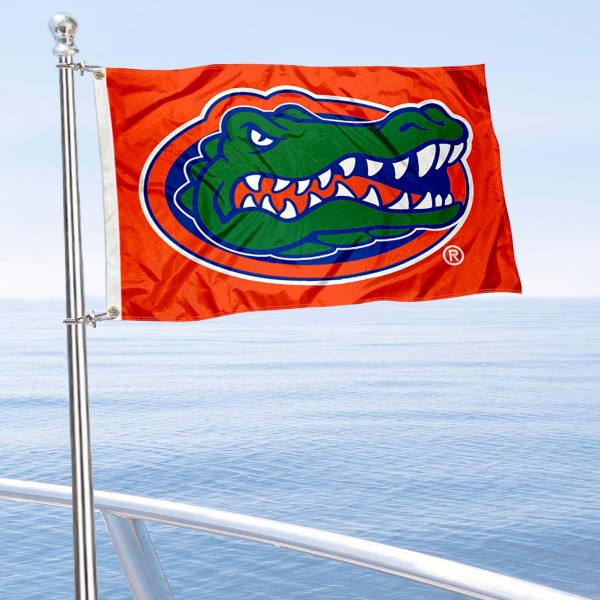 Florida UF Gators Orange Boat Flag is 12x18 inches, nylon, offers quadruple stitched flyends for durability, has two metal grommets, and is double sided. Our mini flags for Florida UF Gators are licensed by the university and NCAA and can be used as a boat flag, motorcycle flag, golf cart flag, or ATV flag.