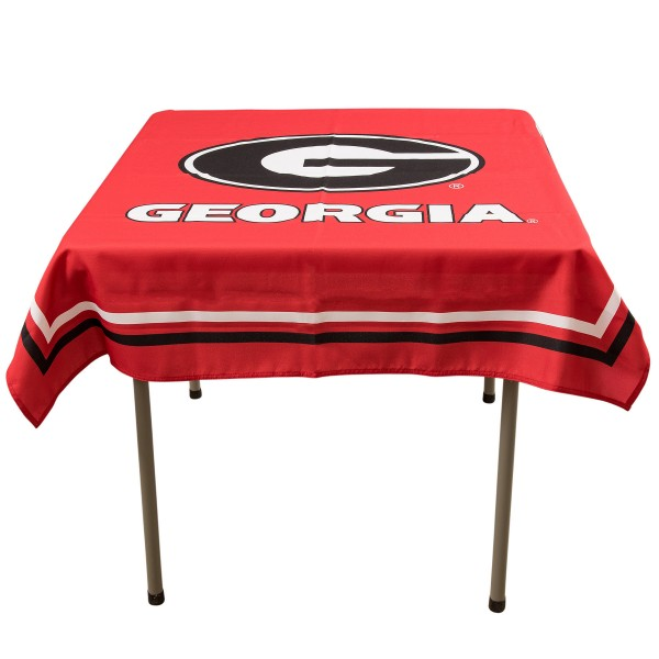 Georgia Bulldogs Table Cloth measures 48 x 48 inches, is made of 100% Polyester, seamless one-piece construction, and is perfect for any tailgating table, card table, or wedding table overlay. Each includes Officially Licensed Logos and Insignias.