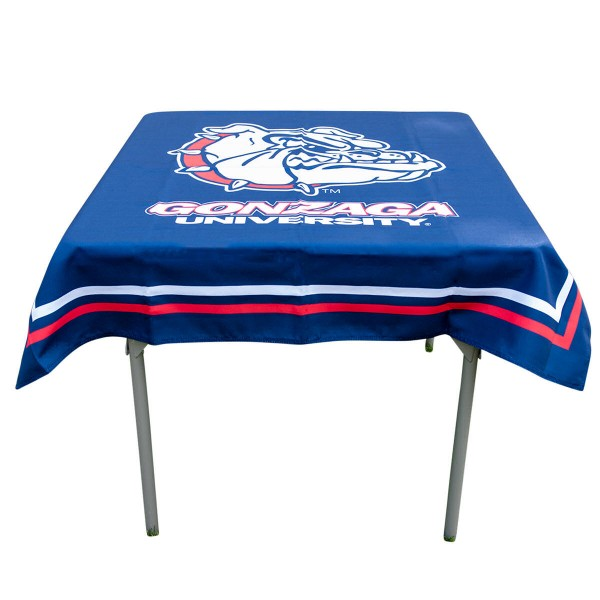 Gonzaga Bulldogs Table Cloth measures 48 x 48 inches, is made of 100% Polyester, seamless one-piece construction, and is perfect for any tailgating table, card table, or wedding table overlay. Each includes Officially Licensed Logos and Insignias.