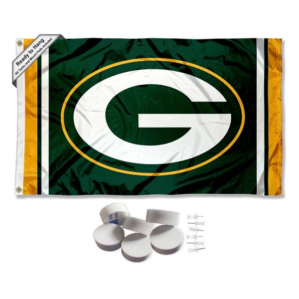 Our Green Bay Packers Banner Flag with Tack Wall Pads is double sided, made of poly, 3'x5', has two metal grommets, indoor or outdoor, and four-stitched fly ends. These Green Bay Packers Banner Flag with Tack Wall Padss are Officially Approved by the Green Bay Packers. Tapestry Wall Hanging Tack Pads which include a 6 pack of banner display pads with 6 tacks allowing you to hang your pennant on any wall damage-free.