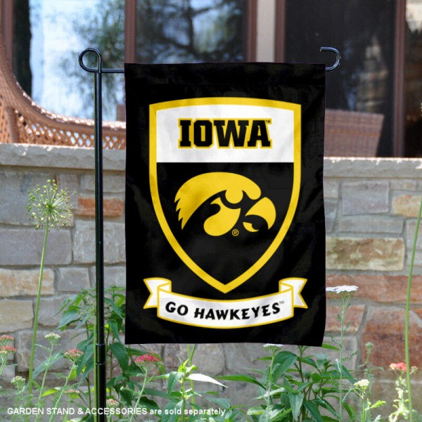 Iowa Hawkeyes Go Hawkeyes Shield Garden Flag is 13x18 inches in size, is made of thick blockout polyester, screen printed university athletic logos and lettering, and is readable and viewable correctly on both sides. Available same day shipping, our Iowa Hawkeyes Go Hawkeyes Shield Garden Flag is officially licensed and approved by the university and the NCAA.