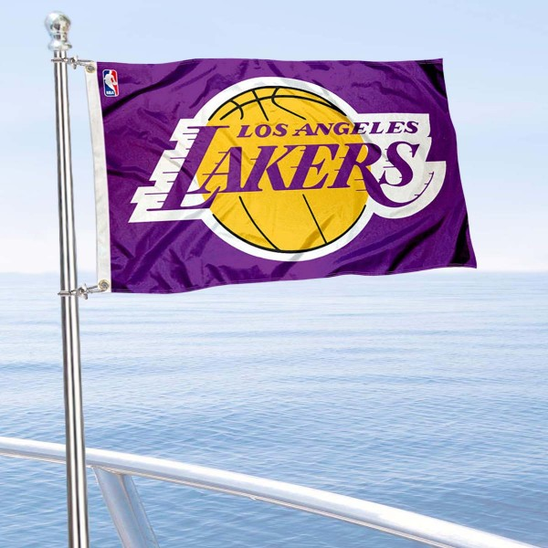 """Our Los Angeles Lakers Boat and Nautical Flag is 12""""x18"""", made of three-ply poly, has a solid header with two metal grommets, and is double sided. This Boat and Nautical Flag for Los Angeles Lakers is Officially Licensed by the NBA and can also be used as a motorcycle flag, boat flag, golf cart flag, or recreational flag."""