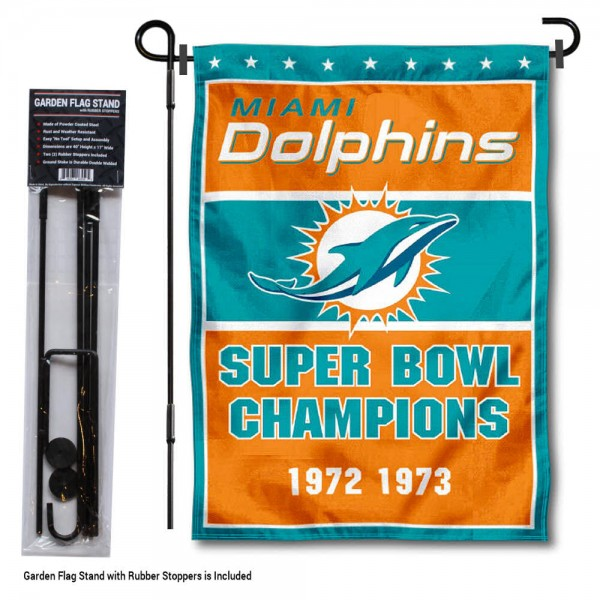 """Miami Dolphins 2 Time Champions Garden Banner and Flag Stand kit includes our 13""""x18"""" garden banner which is made of 2 ply poly with liner and has screen printed licensed logos. Also, a 40""""x17"""" inch garden flag stand is included so your Miami Dolphins 2 Time Champions Garden Banner and Flag Stand is ready to be displayed with no tools needed for setup. Fast Overnight Shipping is offered and the flag is Officially Licensed and Approved by the selected team."""