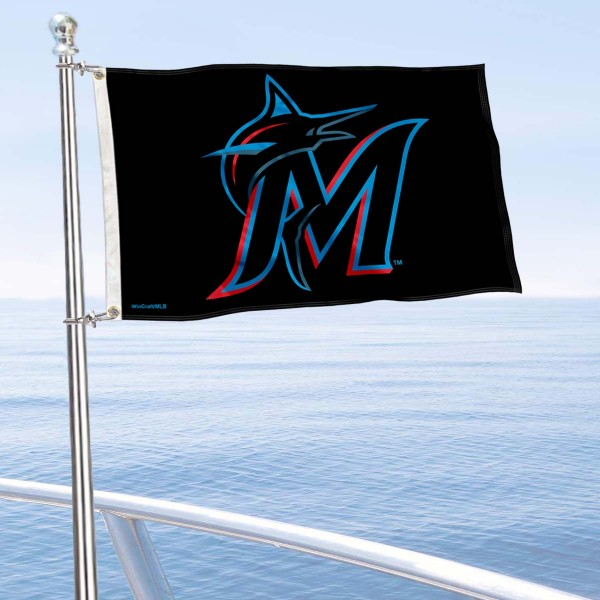 """Our Miami Marlins Boat and Nautical Flag is 12""""x18"""", made of three-ply poly, has a solid header with two metal grommets, and is double sided. This Boat and Nautical Flag for Miami Marlins is Officially Licensed by the MLB and can also be used as a motorcycle flag, boat flag, golf cart flag, or recreational flag."""