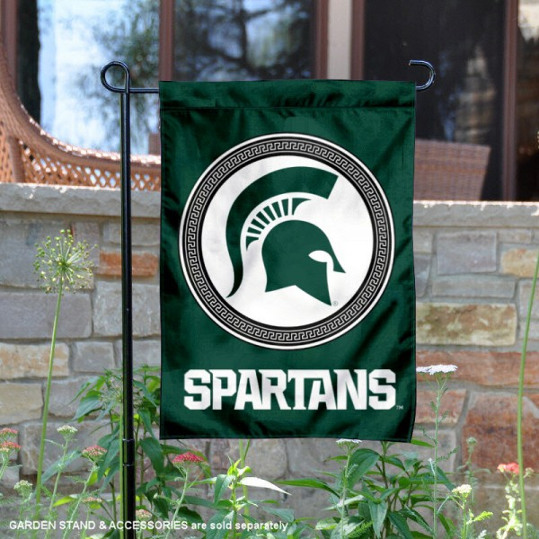 Michigan State Spartans Double Sided Shield Logo Garden Flag is 13x18 inches in size, is made of 2-layer polyester, screen printed university athletic logos and lettering, and is readable and viewable correctly on both sides. Available same day shipping, our Michigan State Spartans Double Sided Shield Logo Garden Flag is officially licensed and approved by the university and the NCAA.