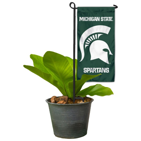 "Michigan State Spartans Flower Pot Topper Flag kit includes our 4""x8"" mini garden banner and 6"" x 14"" mini garden banner stand. The mini flag is made of 1-ply polyester, has screen printed logos and the garden stand is made of steel and powder coated black. This kit is NCAA Officially Licensed by the selected college or university."