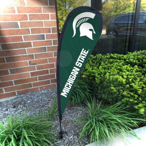 Michigan State Spartans Small Feather Flag measures a 4' tall when fully assembled and roughly 1' wide. The kit includes a Feather Flag, 2 Piece Fiberglass Pole, pole connector, and matching Ground Stake. Our Michigan State Spartans Small Feather Flag easily assembles and is NCAA Officially Licensed by the selected school or university.