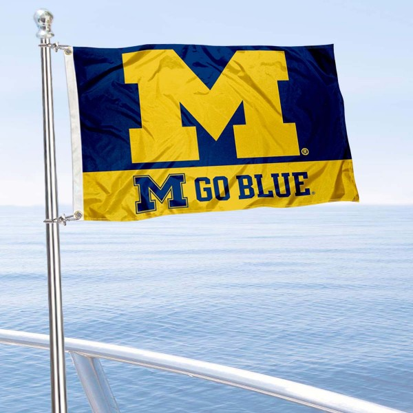Michigan Wolverines Go Blue Boat Flag is 12x18 inches, nylon, offers quadruple stitched flyends for durability, has two metal grommets, and is double sided. Our mini flags for Michigan Wolverines are licensed by the university and NCAA and can be used as a boat flag, motorcycle flag, golf cart flag, or ATV flag.