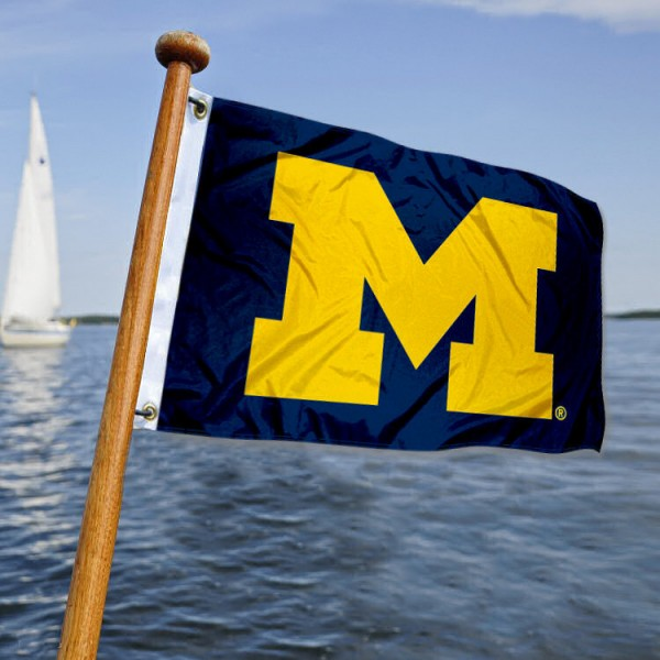 Michigan Wolverines Nautical Flag measures 12x18 inches, is made of two-ply polyesters, offers quadruple stitched flyends for durability, has two metal grommets, and is viewable from both sides. Our Michigan Wolverines Nautical Flag is officially licensed by the selected university and the NCAA and can be used as a motorcycle flag, golf cart flag, or ATV flag