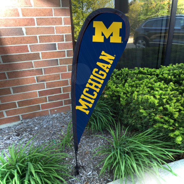 Michigan Wolverines Small Feather Flag measures a 4' tall when fully assembled and roughly 1' wide. The kit includes a Feather Flag, 2 Piece Fiberglass Pole, pole connector, and matching Ground Stake. Our Michigan Wolverines Small Feather Flag easily assembles and is NCAA Officially Licensed by the selected school or university.