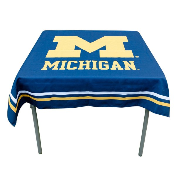 Michigan Wolverines Table Cloth measures 48 x 48 inches, is made of 100% Polyester, seamless one-piece construction, and is perfect for any tailgating table, card table, or wedding table overlay. Each includes Officially Licensed Logos and Insignias.