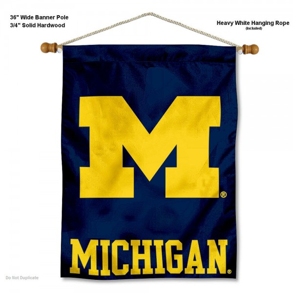 """Michigan Wolverines Wall Banner is constructed of polyester material, measures a large 30""""x40"""", offers screen printed athletic logos, and includes a sturdy 3/4"""" diameter and 36"""" wide banner pole and hanging cord. Our Michigan Wolverines Wall Banner is Officially Licensed by the selected college and NCAA."""
