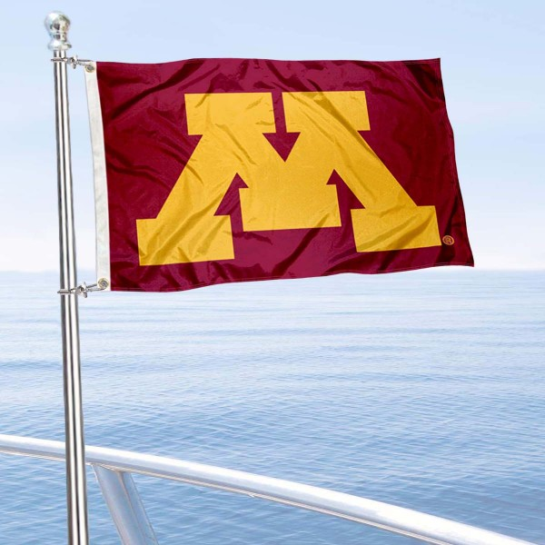 Minnesota Gophers Maroon Boat Flag is 12x18 inches, nylon, offers quadruple stitched flyends for durability, has two metal grommets, and is double sided. Our mini flags for Minnesota Gophers are licensed by the university and NCAA and can be used as a boat flag, motorcycle flag, golf cart flag, or ATV flag.