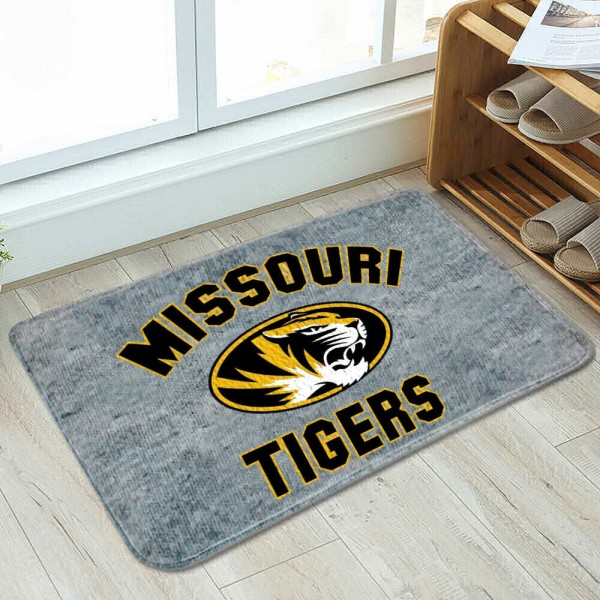 Missouri Tigers Cushioned Floor Bathmat measures 17x26 inches rectangular, is made of polyester felt blends, has a durable non-slip rubber backing, and is UV, mildew, and stain resistant. Each college bath mat includes Officially Licensed Logos and Insignias.