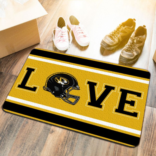 Missouri Tigers LOVE Garage Man Cave Utility Doormat measures 17x25 inches rectangular, is made of polyester felt blends, has a durable non-slip rubber backing, and is UV, mildew, and stain resistant. Each college doormat includes Officially Licensed Logos and Insignias.