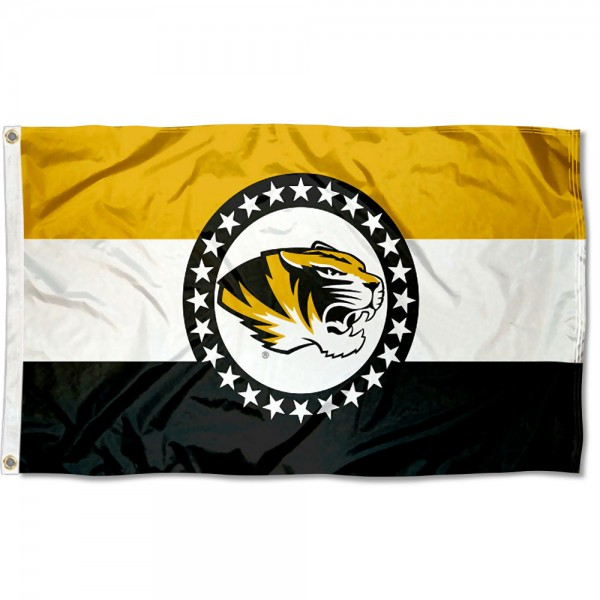 Missouri Tigers State of MO Flag measures 3x5 feet, is made of 100% polyester, offers quadruple stitched flyends, has two metal grommets, and offers screen printed NCAA team logos and insignias. Our Missouri Tigers State of MO Flag is officially licensed by the selected university and NCAA.