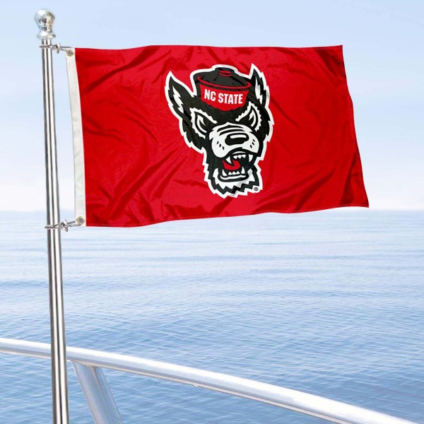 NC State Wolfpack Wolf Logo Boat and Mini Flag is 12x18 inches, polyester, offers quadruple stitched flyends for durability, has two metal grommets, and is double sided. Our mini flags for North Carolina State University are licensed by the university and NCAA and can be used as a boat flag, motorcycle flag, golf cart flag, or ATV flag.