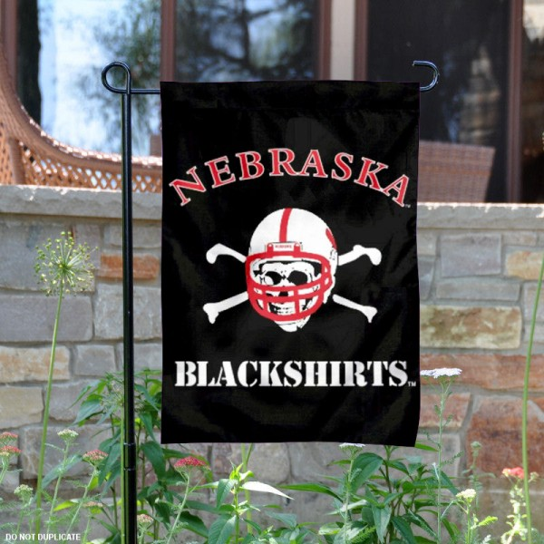 Nebraska Blackshirts Garden Flag is 13x18 inches in size, is made of 2-layer polyester, screen printed University of Nebraska athletic logos and lettering. Available with Same Day Express Shipping, Our Nebraska Blackshirts Garden Flag is officially licensed and approved by University of Nebraska and the NCAA.