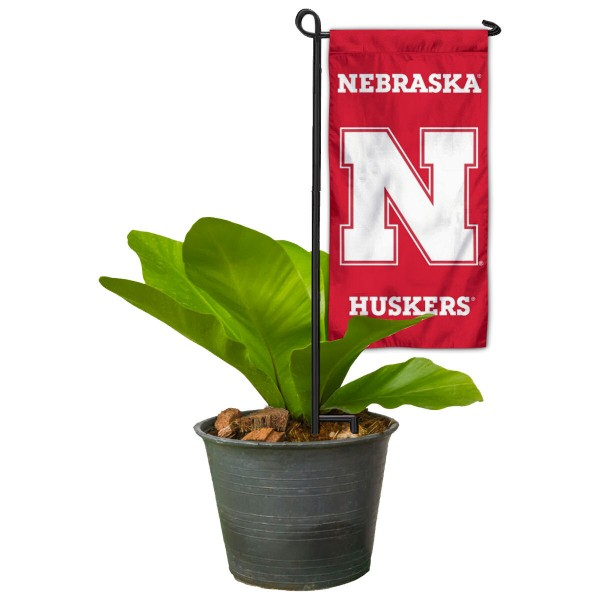 """Nebraska Cornhuskers Flower Pot Topper Flag kit includes our 4""""x8"""" mini garden banner and 6"""" x 14"""" mini garden banner stand. The mini flag is made of 1-ply polyester, has screen printed logos and the garden stand is made of steel and powder coated black. This kit is NCAA Officially Licensed by the selected college or university."""