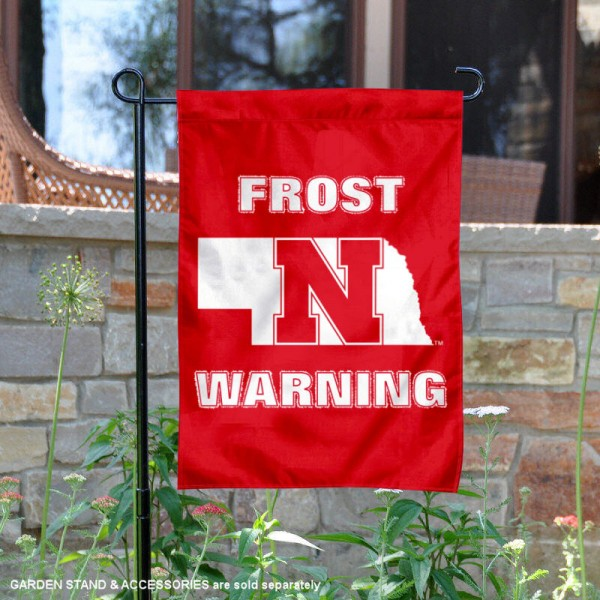 Nebraska Cornhuskers Frost Warning Garden Flag is 13x18 inches in size, is made of 2-layer polyester, screen printed university athletic logos and lettering, and is readable and viewable correctly on both sides. Available same day shipping, our Nebraska Cornhuskers Frost Warning Garden Flag is officially licensed and approved by the university and the NCAA.
