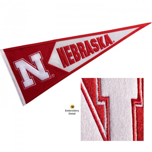 Nebraska Cornhuskers Genuine Wool Pennant consists of our full size 13x32 inch Winning Streak Sports wool college pennant. The logos, lettering and insignia is quality embroidered and appliqued, feature a alternate logo color header, and has sewn wool perimeter. This Nebraska Cornhuskers College Pennant Pennant is Officially Licensed and University Approved with Overnight Next Day Shipping.