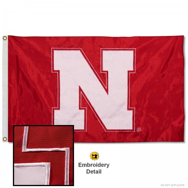 Nebraska Cornhuskers Nylon Embroidered Flag measures 3'x5', is made of 100% nylon, has quadruple flyends, two metal grommets, and has double sided appliqued and embroidered University logos. These Nebraska Cornhuskers 3x5 Flags are officially licensed by the selected university and the NCAA.