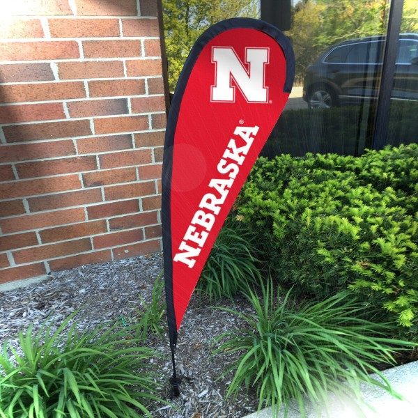 Nebraska Cornhuskers Small Feather Flag measures a 4' tall when fully assembled and roughly 1' wide. The kit includes a Feather Flag, 2 Piece Fiberglass Pole, pole connector, and matching Ground Stake. Our Nebraska Cornhuskers Small Feather Flag easily assembles and is NCAA Officially Licensed by the selected school or university.